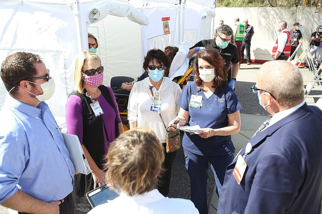 About 75 to 100 employees of the hospital, Nevada County, local EMS, and Hospice of the Foothills took part in a high surge COVID drill to test their ability to handle the potential of a surge in coronavirus cases. For video of the event go to www.theunion.com.