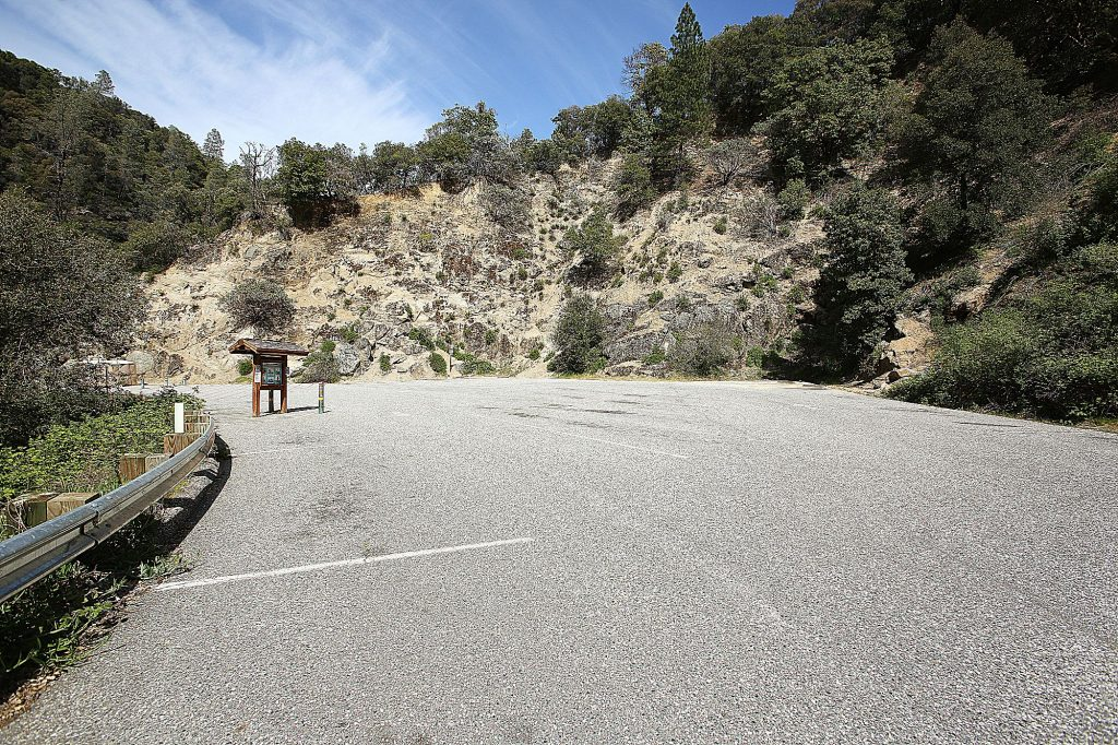 The parking lot at the Highway 49 bridge of the South Yuba River was empty during Earth Day on Wednesday due to the COVID-19 parking lot shutdowns of state parks within the Sierra District.