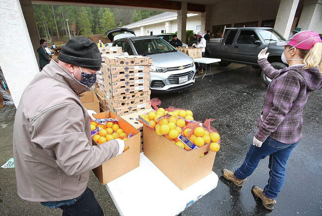 About 25 Food Bank of Nevada County staff and volunteers were hard at work Thursday helping to serve about 2,500 area residents with food assistance at a drive-thru set up at Grass Valley Seventh-day Adventist Church.