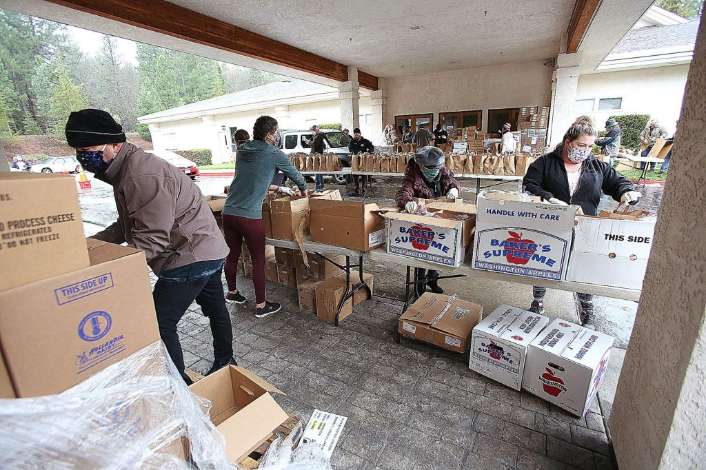 An additional 1,200 food bags were packed on the fly by volunteers during Thursday's drive-thru food bank distribution.