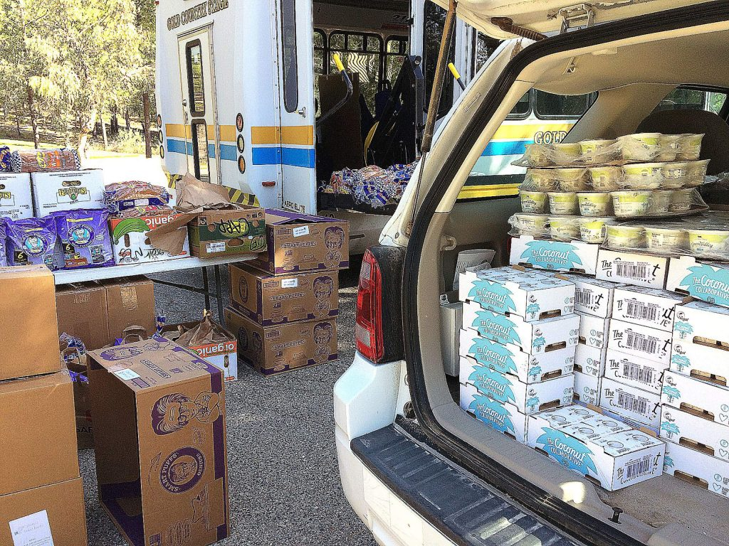 Nevada County vehicles, including the Gold Country Stage, made for good food transportation for Thursday's drive-thru food distribution at Grizzly Hill School on the San Juan Ridge.