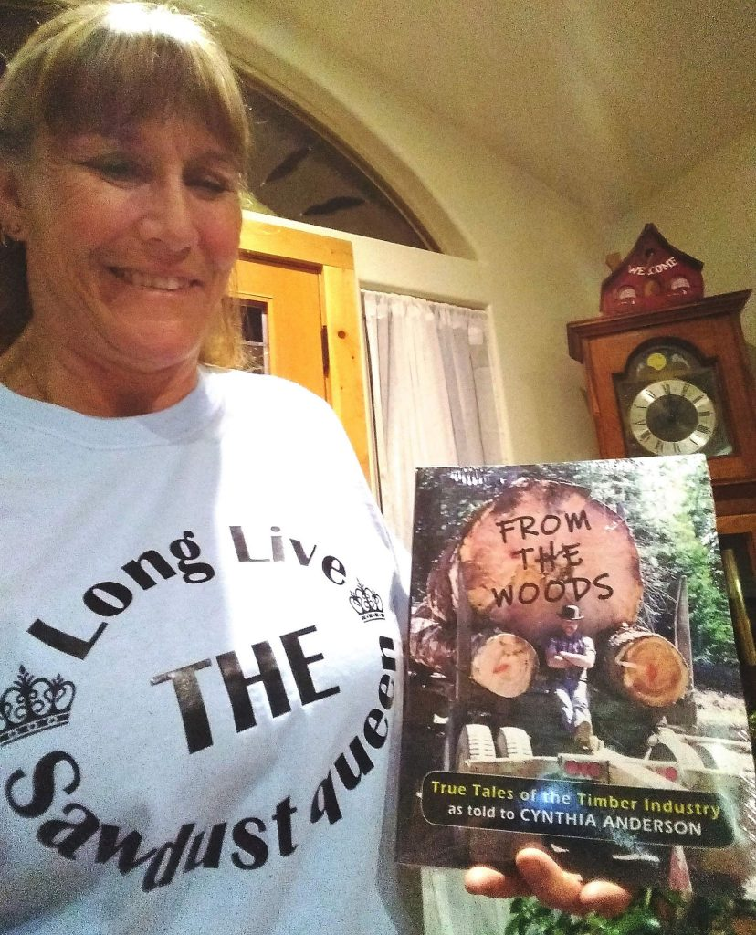 """Cindi Anderson, author of the book """"From the Woods"""" that chronicles the local timber industry, was gifted a unique T-shirt that reads """"Long Live the Sawdust Queen."""""""
