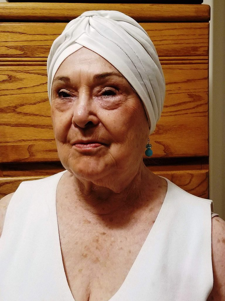 Lee Hudson is a devoted and determined environmentalist known for wearing iconic turbans and scarves.