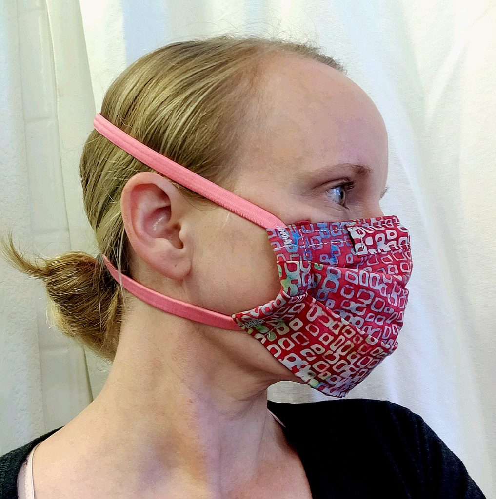 Rebecca Seijas-Ball is team captain in charge of testing masks and filters. Here, she models a tight-fitting mask with elastic head bands.