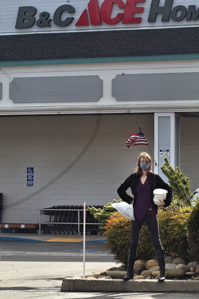 Lexis LaRue is called Wonder Woman by her NV Masks compatriots. A professional theatrical actor, LaRue obligingly struck a Wonder Woman pose in front of B&C Ace Hardware in Grass Valley.