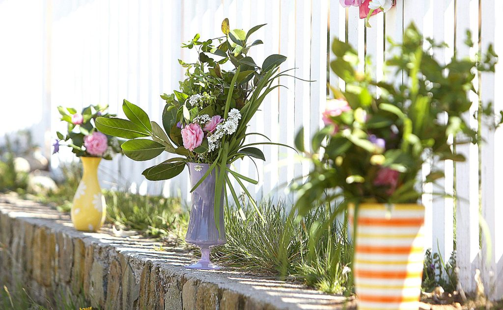 Angela Rule's flower arrangements come in multiple sizes with different colored vases to choose from as well.