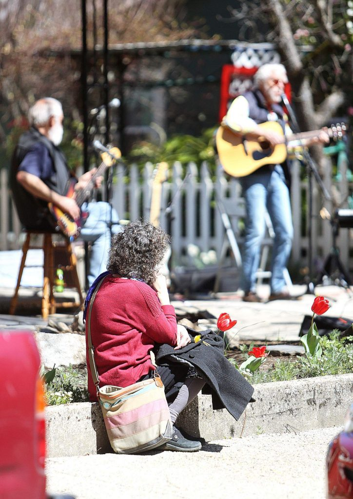 A handful of passersby stopped to take in the live jam session of The Elderly Brothers and friends Thursday afternoon in Nevada City.
