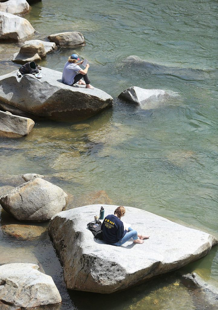 Folks at the South Yuba River seem to be heeding the social distancing recommendations by sitting on separate rocks.