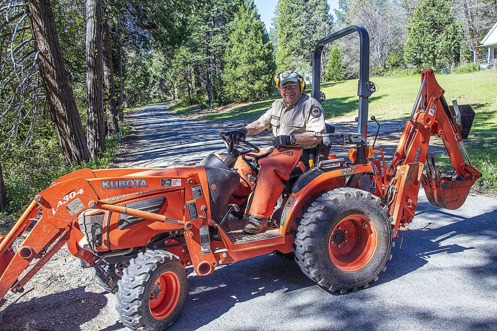 Tom Stark working to clear trails from winter trees, branches, etc. at Malakoff Diggins State Historic Park getting ready for the time visitors will return.