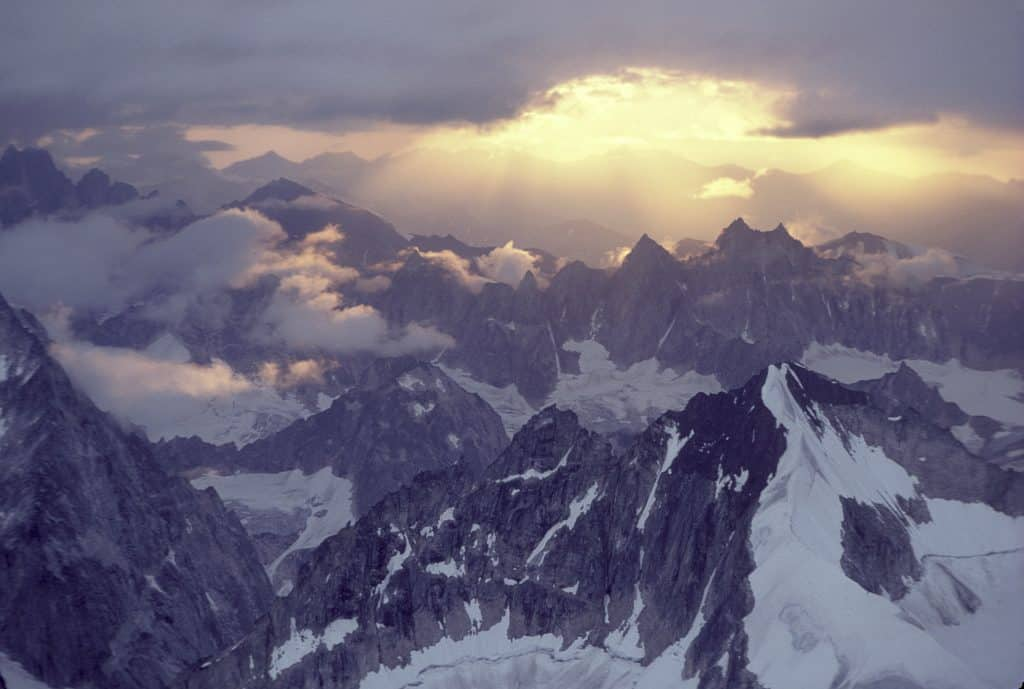 A spectacular sunset illuminatse the rugged peaks in the Cathedral Spires, in the Alaska Range west of Denali, Alaska.