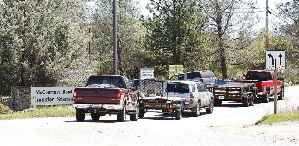 A line of people waiting to make dumps at the McCourtney Road Transfer Station stretches out onto the road last week. Hundreds of people per day has prompted the county to limit the facility to 200 customers each day.