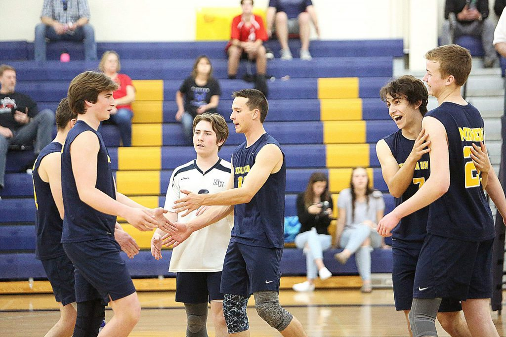 The Miners celebrate after scoring a point during a match in March. The defending Sac-Joaquin Section champion Nevada Union boys volleyball team was off to a strong start and had its sights set on a second straight title run when the season was canceled due to COVID-19.