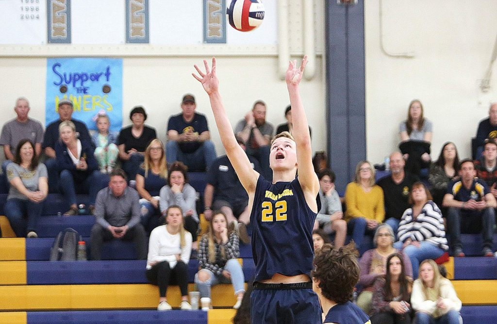 Nevada Union senior Colby Quiggle (22) sets the ball for his teammates during a match earlier this season.