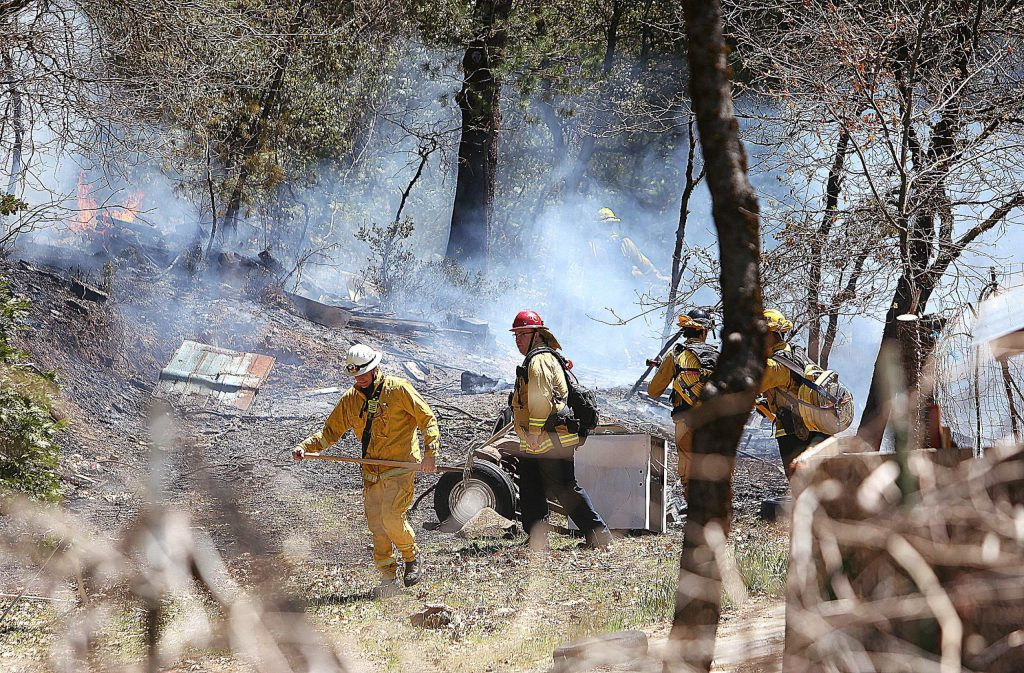 Cal Fire and Grass Valley firefighters work to contain an escaped burn pile in the 12000 block of Gold Starr Lane in rural Grass Valley Thursday afternoon. The fire was quickly knocked down and kept to less than a fourth of an acre.