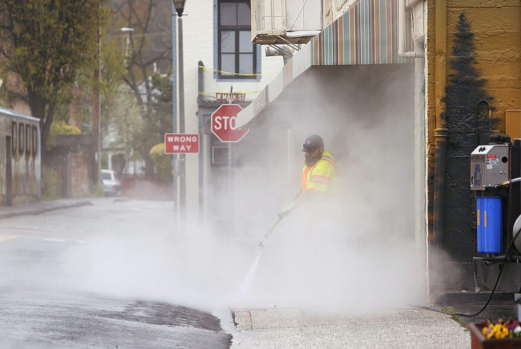 Grass Valley workers used Thursday's drab day to power wash the sidewalks outside the Everhart Hotel.