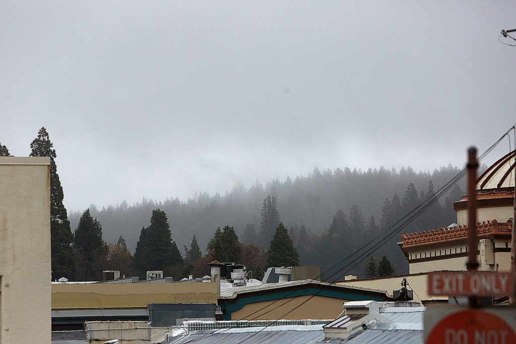 Grass Valley's downtown skyline and forests beyond were draped in a blanket of clouds and mist Thursday.