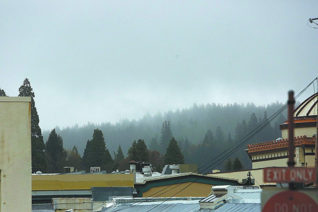 Grass Valley's downtown skyline and forests beyond were draped in a blanket of clouds and mist Wednesday.