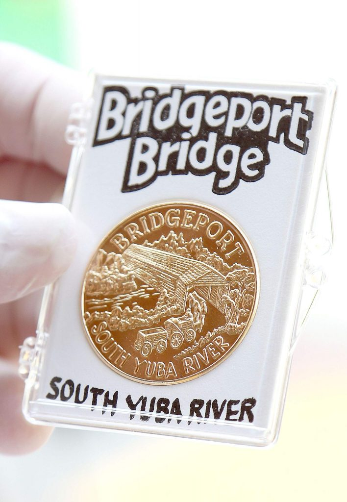 Included in the art awards packets is a coin with an engraving of the Bridgeport Bridge at the South Yuba River.