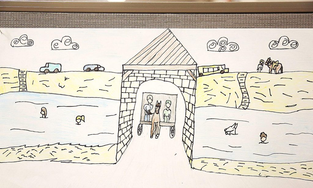 """Student art work for the Bridgeport Covered Bridge contest,""""Flowing Through History,"""" fills the Nevada County Superintendent of School's office."""