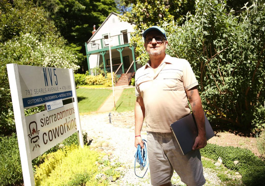 Robert Trent stands in front of his nonprofit Sierra Commons Coworking business in Nevada City's Seven Hills Business District. Trent is advocating for more reliable internet connections.