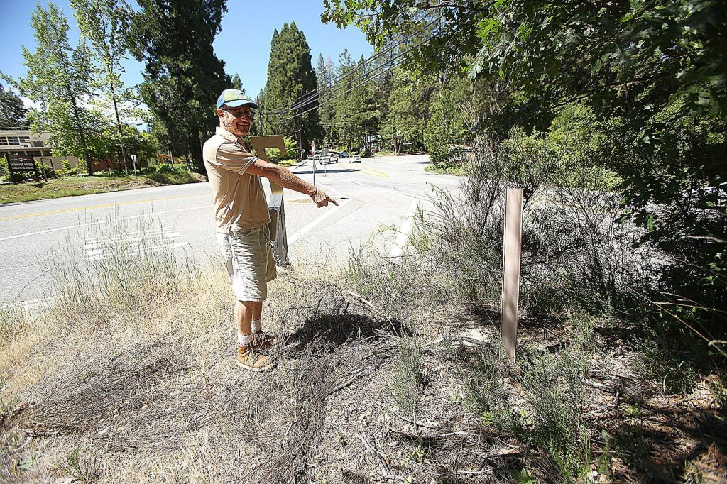 Trent points to a christy box that contains the underground buried fiber optic cable that runs through the Seven Hills Business District in Nevada City.