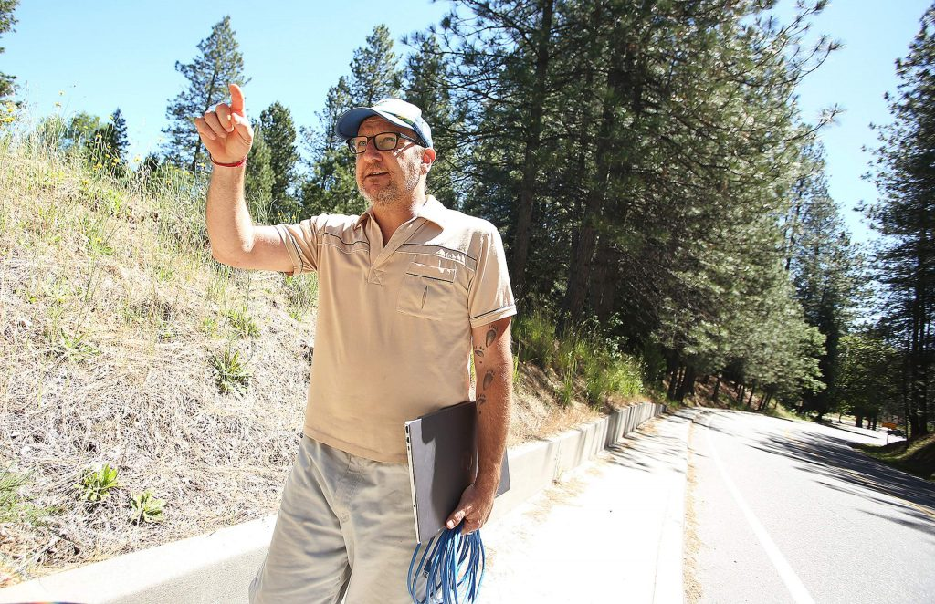 Sierra Commons Business Ignitor's Robert Trent walks along a section of Ridge Road in Nevada City that would cost his nonprofit $50,000 or $1,500 a month to run a fiber optic cable to connect with his business.