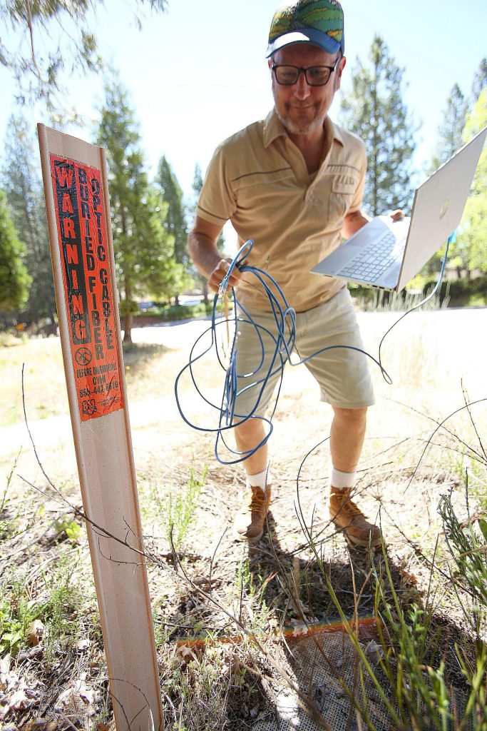 Sierra Commons Business Ignitor's Robert Trent shows where an underground fiber optic cable runs through Nevada City's Seven Hills Business District. The cable and the ability to connect to high speed internet, would cost the nonprofit $50,000 or $1,500 per month.
