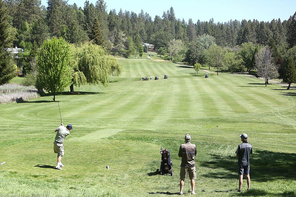 Groups of golfers keep their distance from one another as they take to the greens of Alta Sierra Country Club last week.