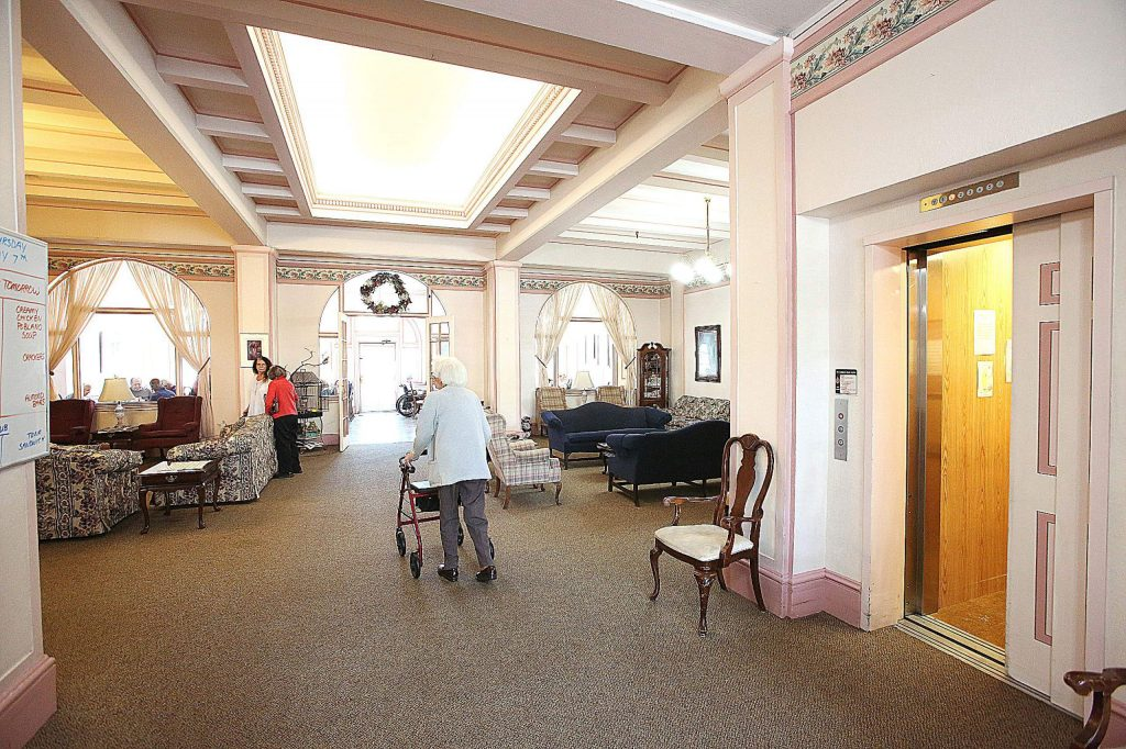 Bret Harte Retirement Inn residents make their way down to the dining room for lunch via the building's elevator.
