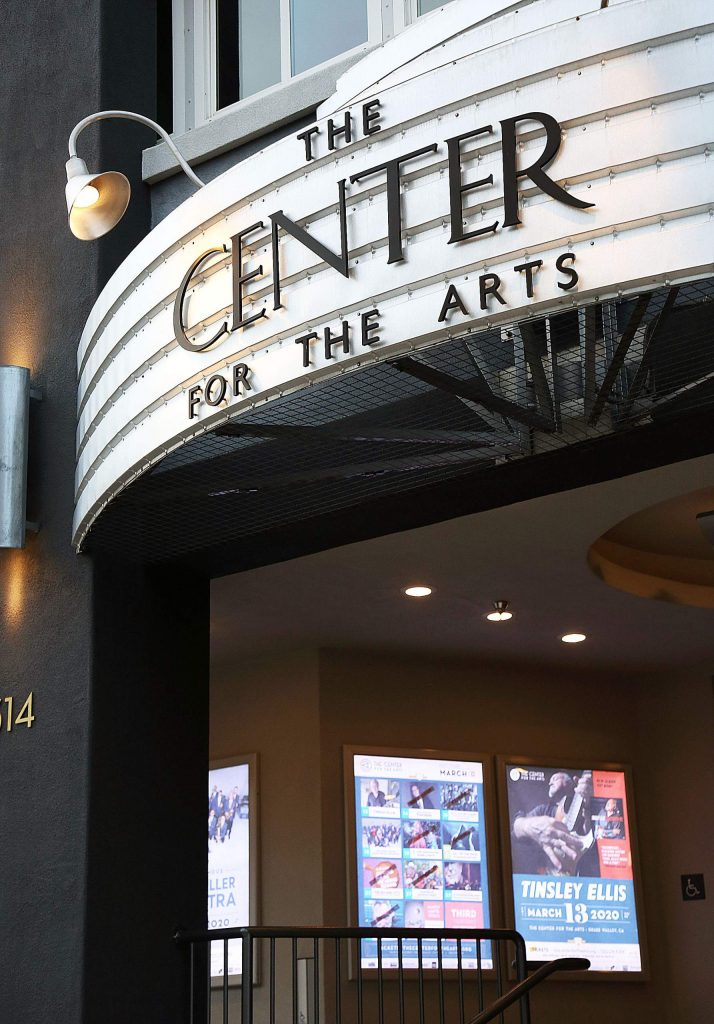 Playbills with postponed or rescheduled shows for March remain posted under the marquee for The Center for the Arts in Grass Valley. The arts venue has yet to fully use its renovated space due to the COVID-19 shutdowns.