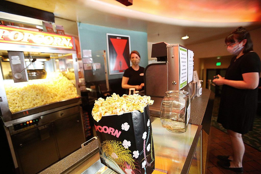 "A bag of freshly popped popcorn awaits Grass Valley's Zoe Toffaleti Thursday afternoon at the Del Oro Theater's snack bar. ""Literally the thing I've been craving the most is theater popcorn,"" Toffaleti said."