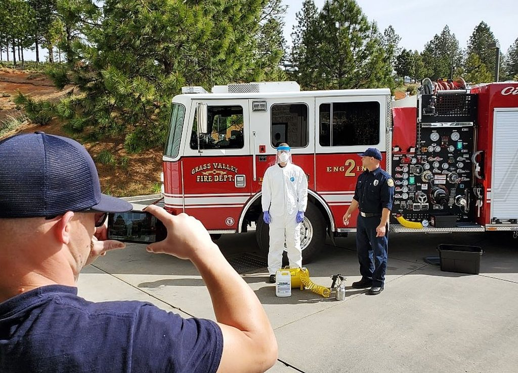 Grass Valley Fire Engineer Roque Barerra helps shoot a video on the decontamination system he designed for the fire department's fire engines for COVID-19.