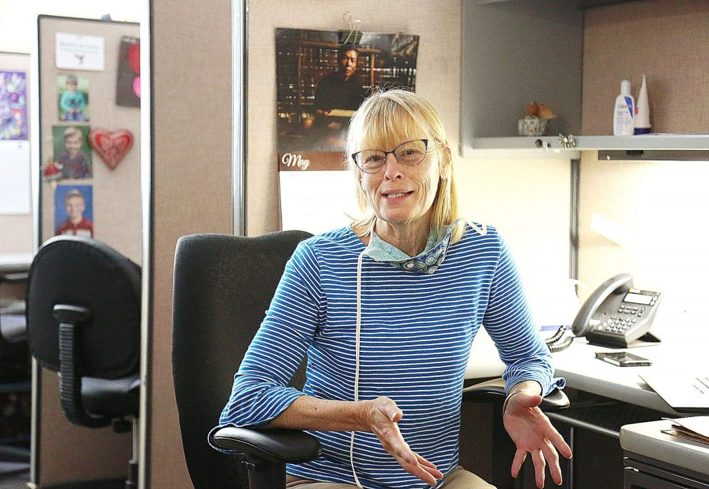Hospice of the Foothills' Teresa Shackelford explains the challenges involved in providing the best end-of-life care as possible during the COVID-19 pandemic. Shackelford sits at her desk where many of her contacts with clients are now made.