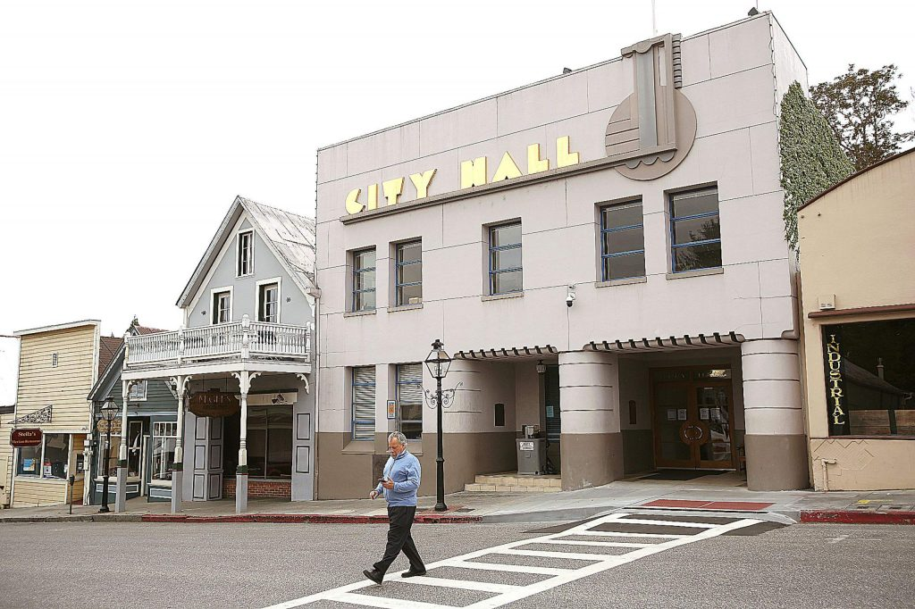 A pedestrian crosses Broad Street in front of Nevada City Hall Wednesday. Some city projects may need to be put on hold due to the potential of financial losses due to Covid-19, though the city will know more after a May 20 meeting.