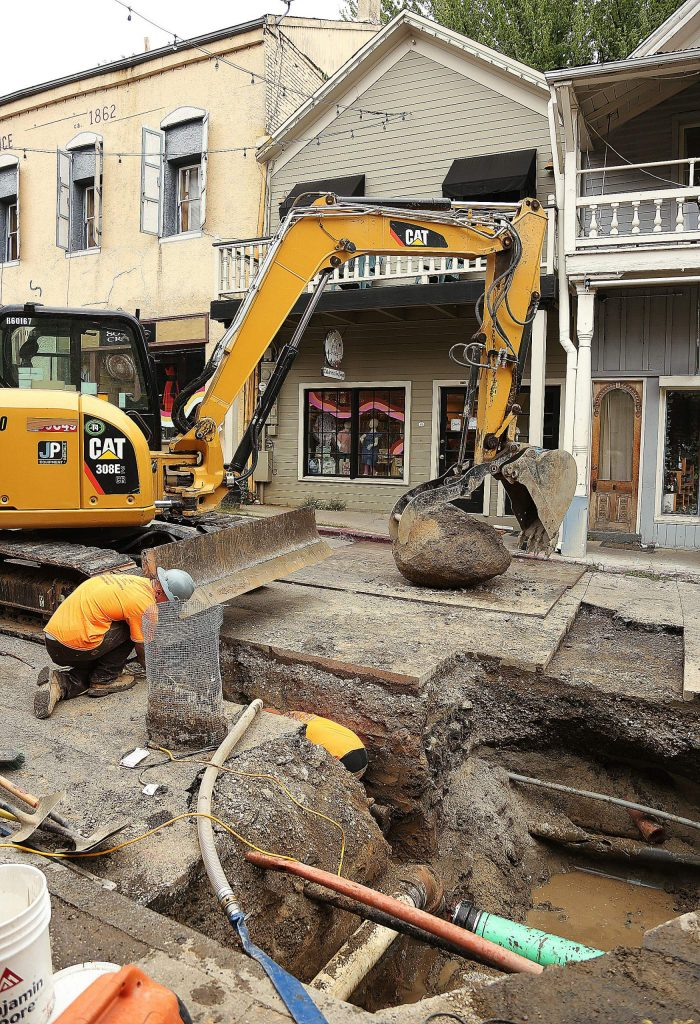 A large boulder was pulled from the middle of commercial street in Nevada City which was causing trouble for workers replacing sewer mains.