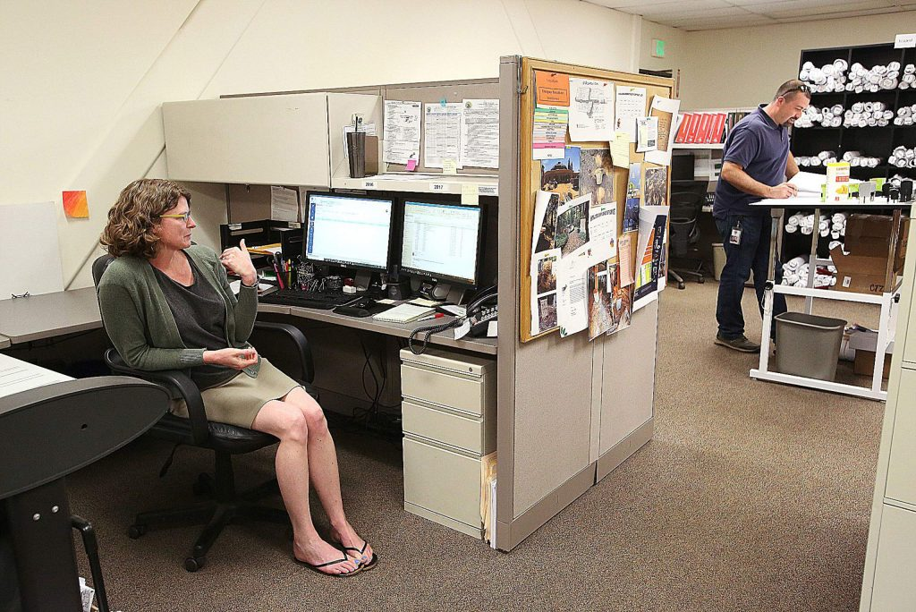 Nevada County's Julie Miller comes to the Rood Center building to answer phone calls to the County's Building Department. Building inspector Ben Miller (no relation), also conducts business from the office when necessary.