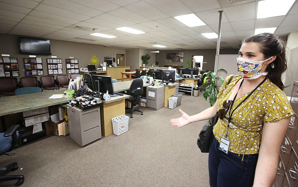 Nevada County Administrative Analyst and Public Information Officer Taylor Wolfe shows the empty building department digs as most employees are working from home now to help prevent the spread of COVID-19.
