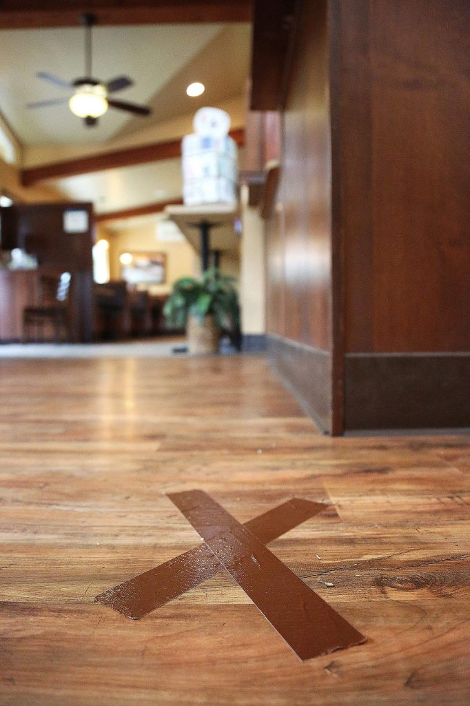 Marks on the floor of Humpty Dumpty's restaurant in Grass Valley show customers where they can stand if they're waiting in line to checkout.