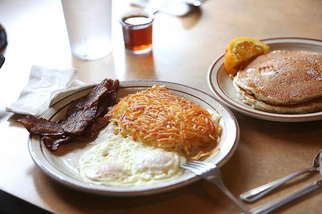Humpty's Favorite, consisting of pancakes, hash browns, eggs and bacon, is served to a longtime customer Thursday morning after reopening.