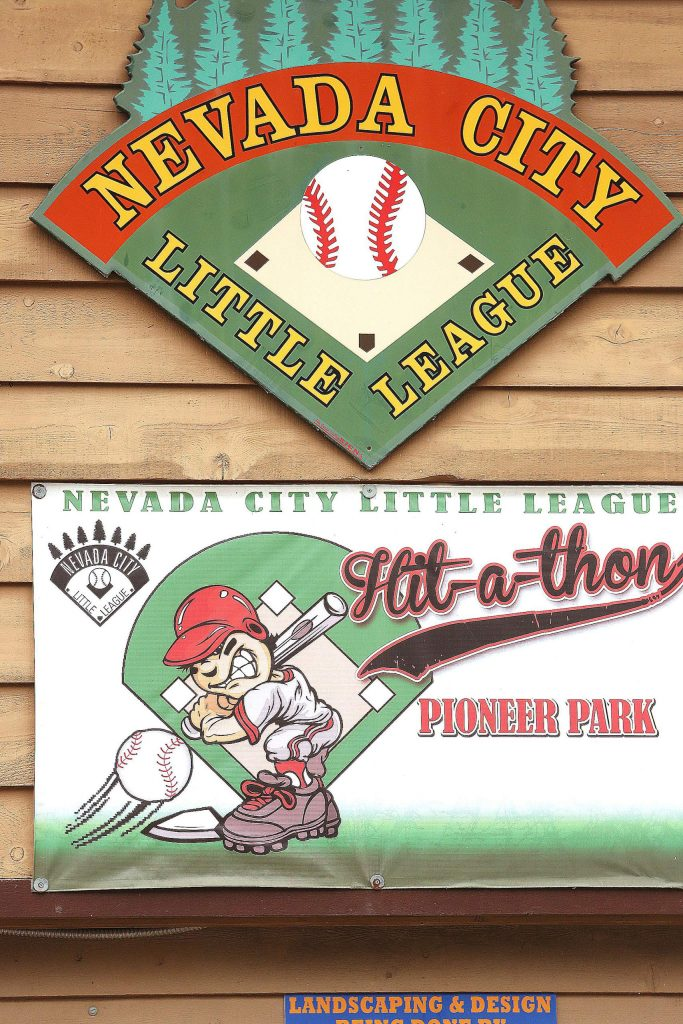 A banner reminding folks of fonder times promotes the Nevada City Little League hit-a-thon held in previous years at Babe Chillder's field in Nevada City's Pioneer Park.