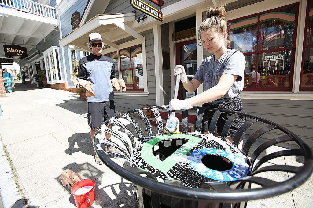 Nevada City held its annual spring clean day Friday morning with a handful of hard working volunteers such as Madison and father Kurt Stockton, who had the task of scrubbing down the trash/recycle bins along Broad Street.