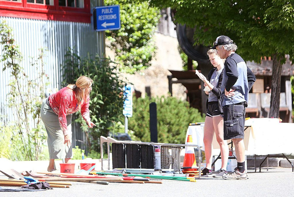 Nevada City Councilwoman Reinette Senum helps dole out cleaning roles to folks helping with Friday's annual Spring Clean Nevada City day.