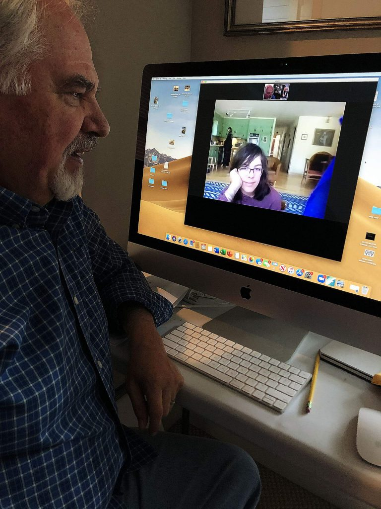 InConcert Sierra Education Director Mark Vance talks with Composer Project student Baraka Anderson via Zoom. With the aid of virtual technology, all 13 students enrolled in the Composer's Project this year are able to finish writing their final of two compositions.