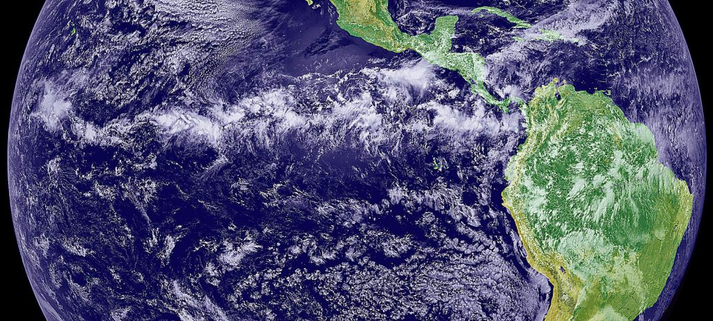 Afternoon clouds build across the Pacific, west of South America.