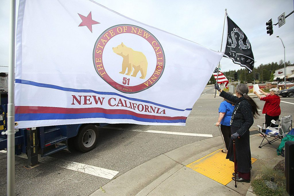 The flag of the proposed 51st state, New California, was flown alongside the Join or Die flag as well as the United States flag during Wednesday's New California.