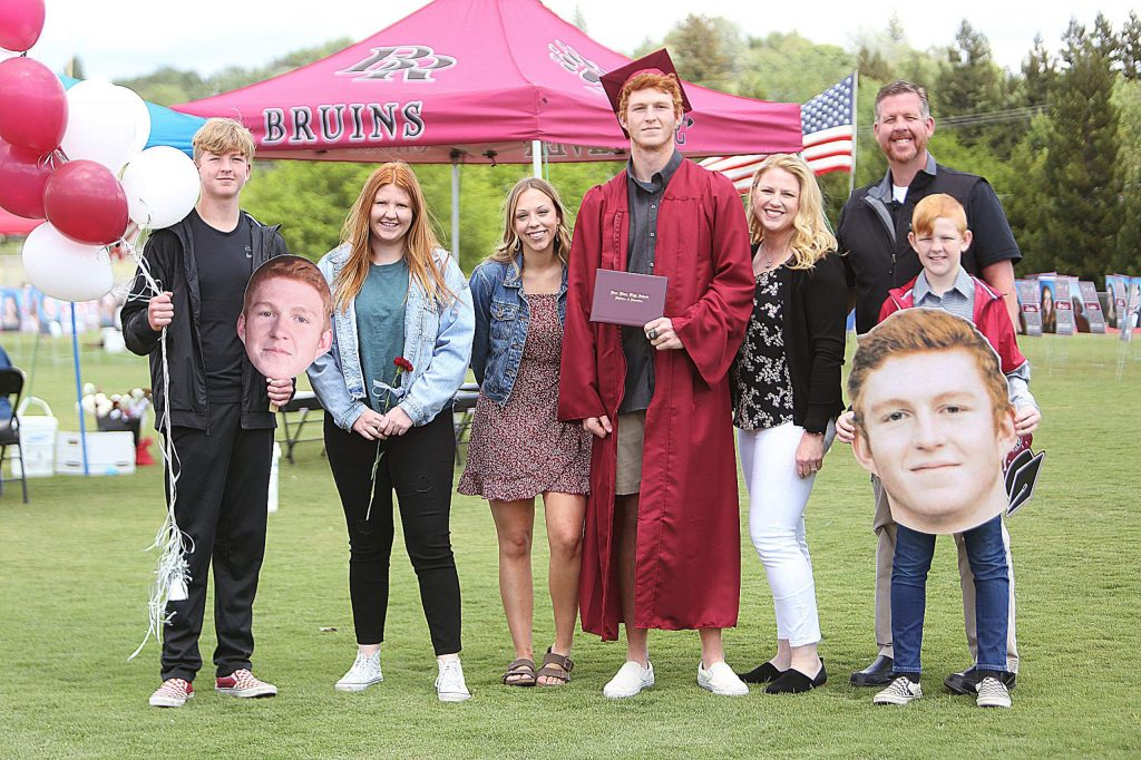 Bear River High School's Bradley Smith smiles with members of his family following Tuesday's drive-up graduation ceremony.