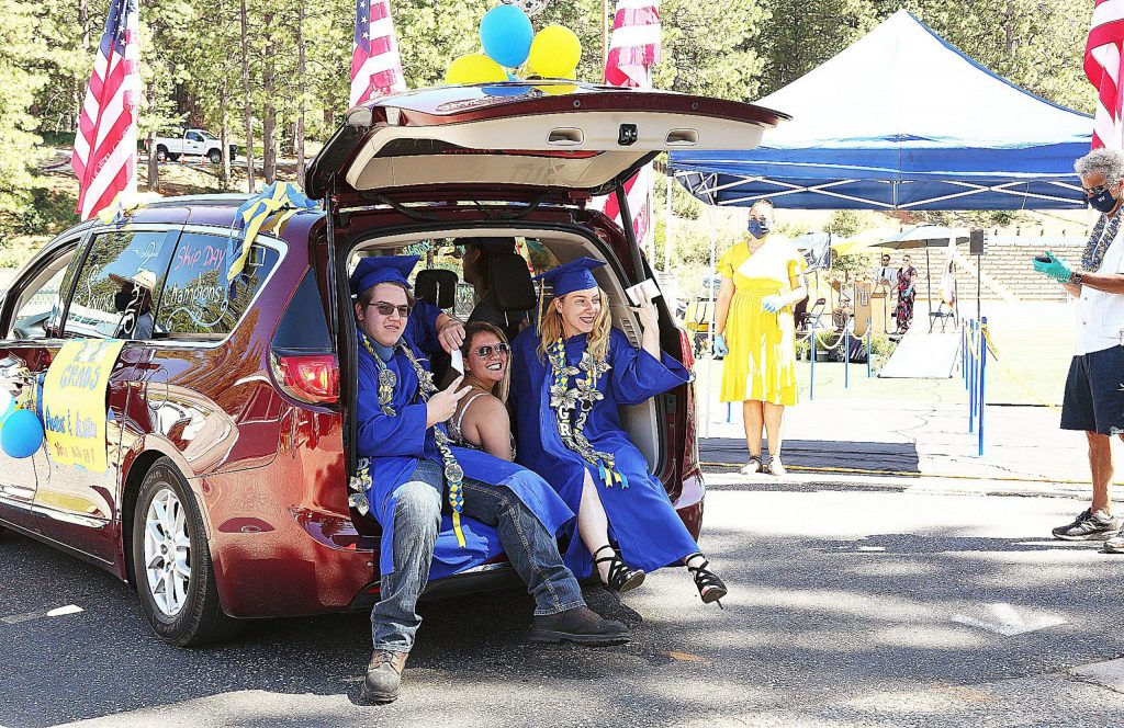 Nevada Union High School held the first of its two days of drive-thru graduations Wednesday at Grass Valley's Hooper Stadium. Vehicles packed with family, friends and graduates gathered at the high school during their allotted time before driving to the stadium where students, such as twins Amber and Austin Fackrell, walked across the stage to receive their diplomas.