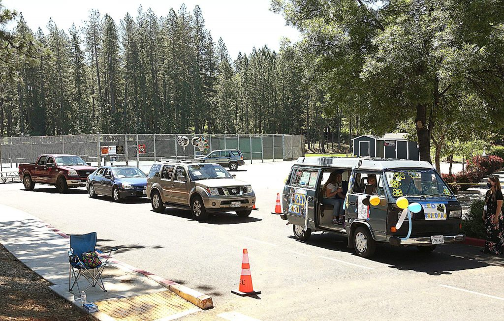 Vehicles wait for their allotted time to drive up to Nevada Union's Hooper Stadium for day one of the drive-thru graduation ceremony.
