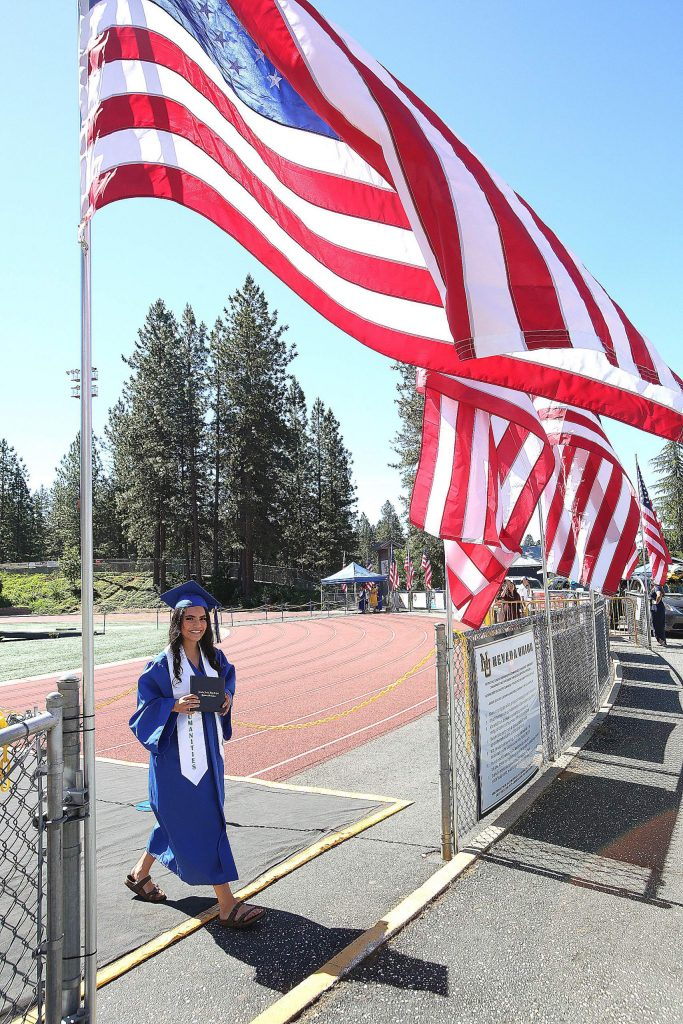 Nevada Union grad Kimberly Rivera Campos smiles as she walks to greet her family after receiving her diploma.