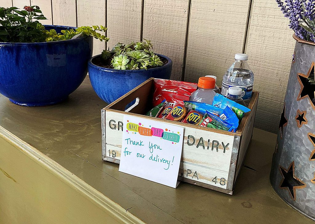 Some homes have tasty treats on front porches with messages thanking delivery workers.
